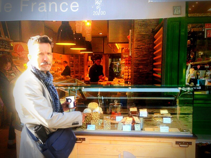 Kevin buying cheese in paris