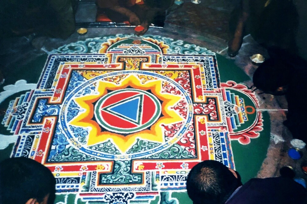 Making a sand mandala with monks in tibet