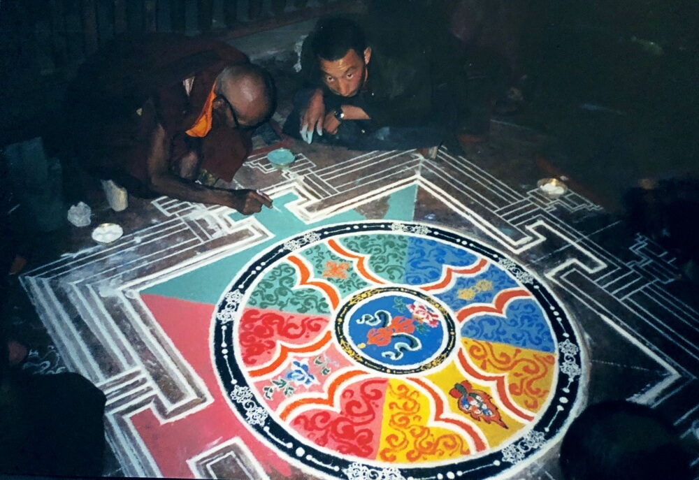 Making a sand mandala with monks in tibet 4