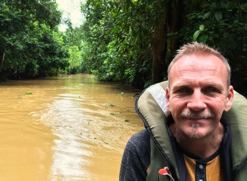 James Ian searchiung for pygmy elephants in Borneo
