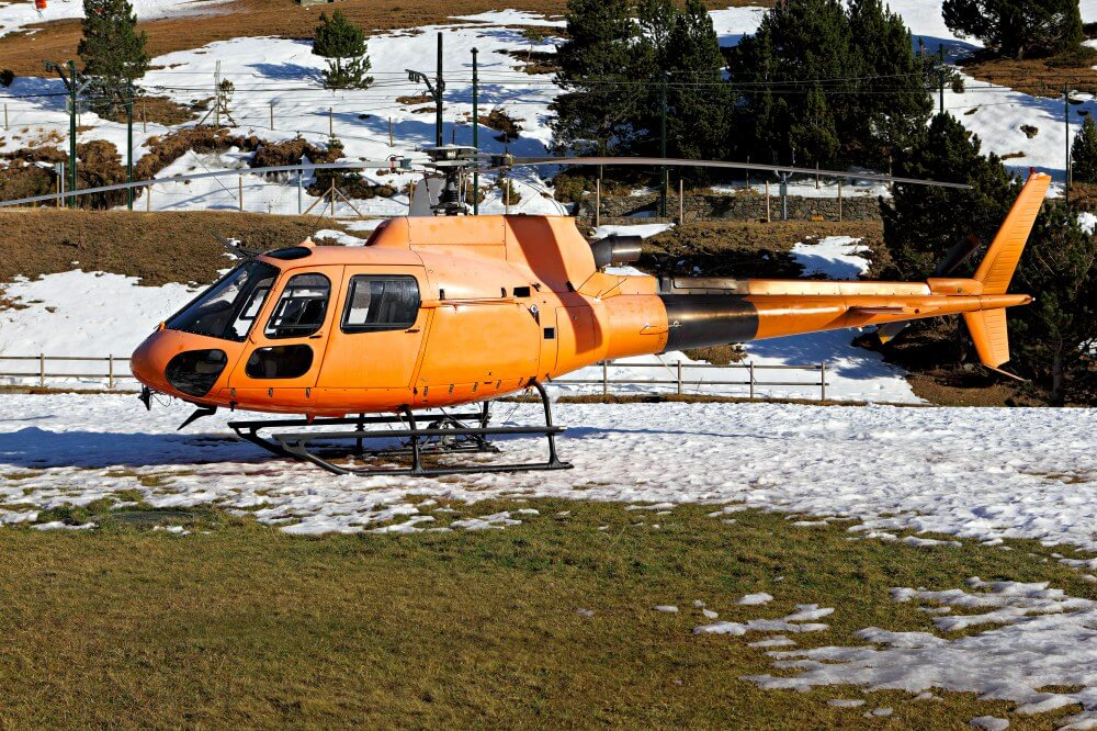 Orange helicopter used for emergency evacuaitons can be paid for under travel insurance