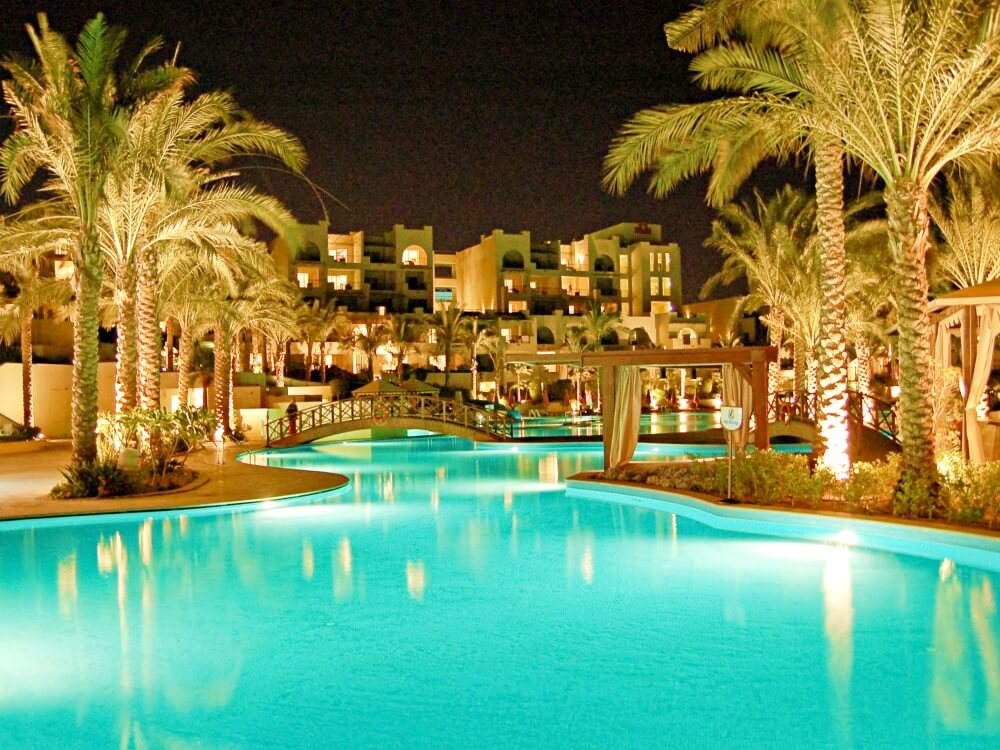 Luxury hotel at night with pool in Egypt