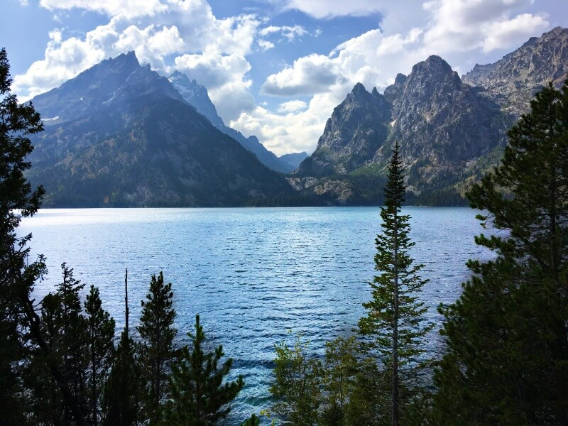 View of GRand Tetons across jenny Lake afternoon on Jenny Lake Loop drive
